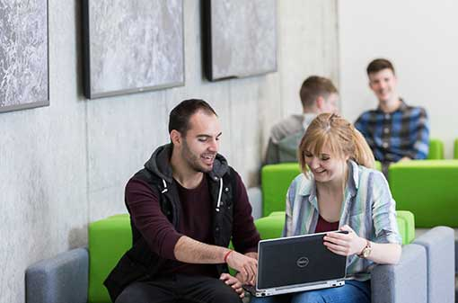 Student Services - students in eolas with pc - Maynooth University