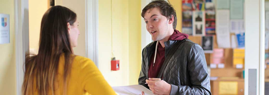 International Office - Student  & staff chatting - Maynooth University