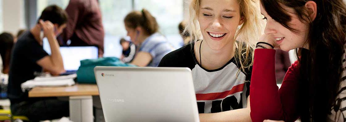 Female students at laptop