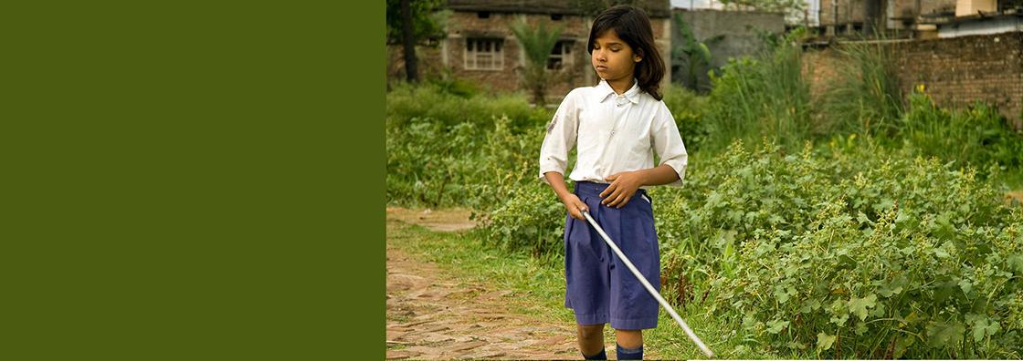 Blind girl using cane