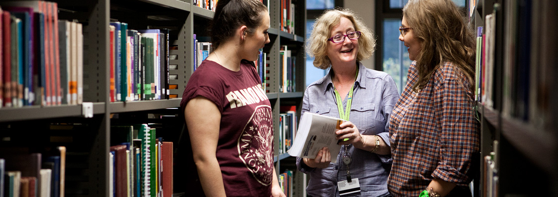 Library Assistant chats to students - Maynooth University
