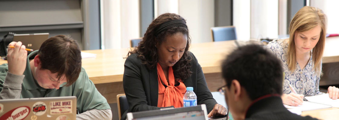 Postgraduate Student Studying in the Library at Maynooth University