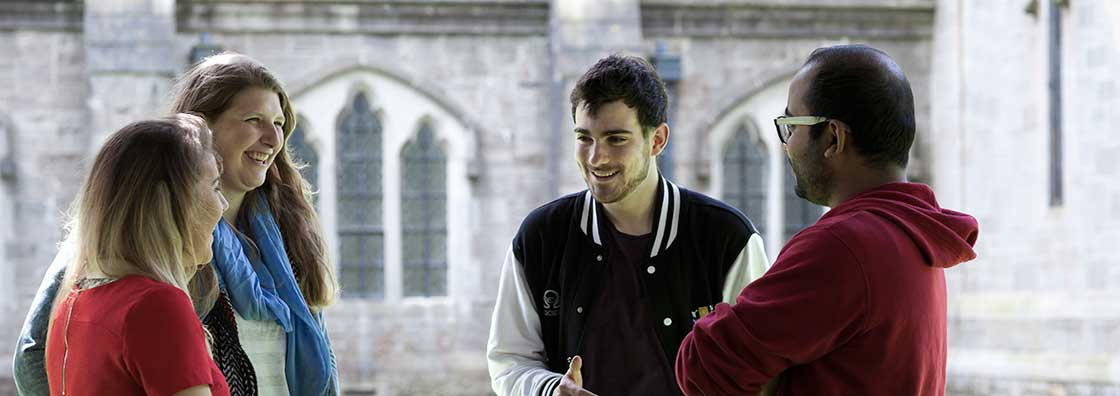 Student Services - four students chatting outdoor - Maynooth University