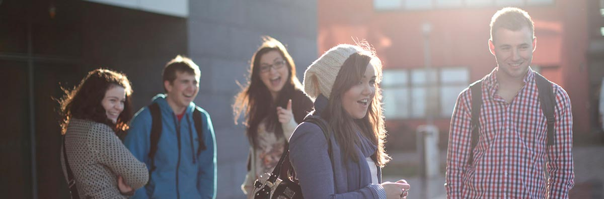 Communications - Students outside Iontas Builiding on Maynooth University 1200 x 396