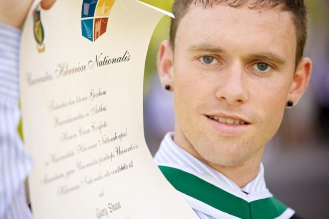 Graduation 2012 - male with scroll - Maynooth University