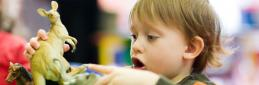 Student Services - boy playing with toy creche carousel 1200 x 200 - Maynooth University