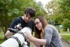 Communications & Marketing - Male and female students at telescope - Maynooth University