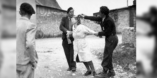 Two men hold a woman by the arms while cutting her hair, another man watches from the corner